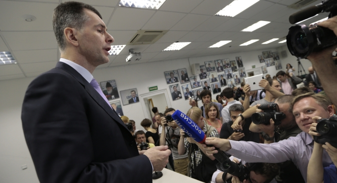 Russian billionaire Mikhail Prokhorov speaks to the media in Moscow, Thursday, June 13, 2013. Prokhorov said he is not running for Moscow mayor. Source: AP