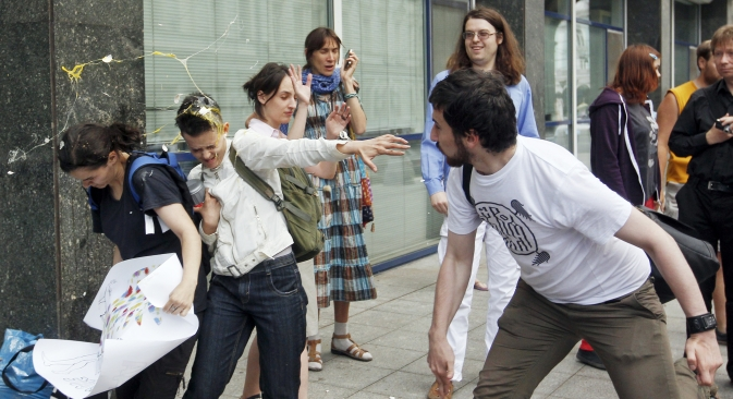 A radical Orthodox believer (R) throws an egg at gay rights activists during a protest against the 'gay propaganda' law in central Moscow June 11, 2013. Source: Reuters