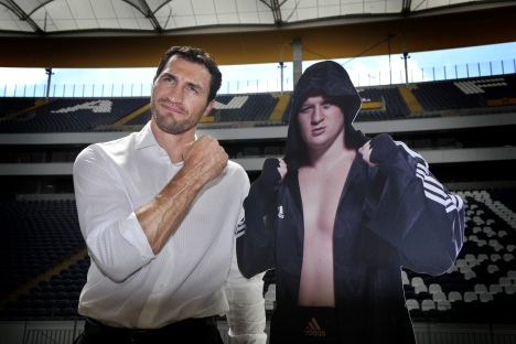 Wladimir Klitschko (L) poses with a photo of his opponent, Alexander Povetkin, at the Commerzbank Arena stadium in Frankfurt, July 19, 2010. The Klitschko-Povetkin fight could take place in 2010, but it was repeatedly postponed. Source: AP