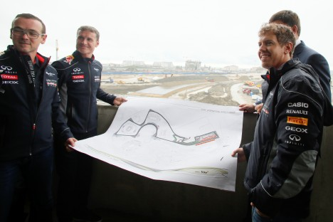 World Champion Sebastian Vettel (foreground right) and a team ambassador David Coulthard (second left) with officials hold a map of the track while visiting the Sochi Olympic Park and site of Russia's first Grand Prix in Sochi, on April 22. Source: AP
