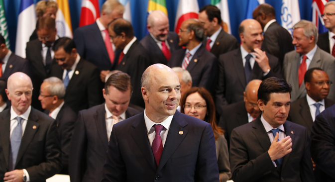 Russia's Finance Minister Anton Siluanov (front) participates in the G20 finance ministers and central bank governors' family photo in Moscow, July 20, 2013. Source: Reuters / Grigory Dukor