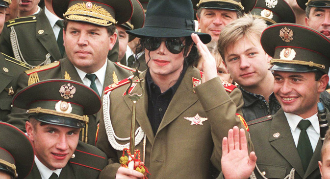 "American popstar Michael Jackson makes a mock military salute, as he is surrounded by Russian army musicians on Moscow's World War II memorial, Wednesday, Sept. 18, 1996. Jackson will leave Moscow Wednesday, after he performed a concert of his 'History"" world tour Tuesday. Source: AP"