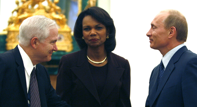 Then-U.S. Secretary of Defense Robert Gates (left) and then-U.S. Secretary of State Condoleezza Rice are greeted by Russian President Vladimir Putin in the Kremlin in 2008. Source: Reuters