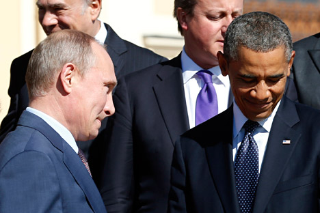 Russian President Vladimir Putin (L) walks past U.S. President Barack Obama (R) and British Prime Minister David Cameron during a group photo at the G20 Summit in St. Petersburg September 6, 2013. Source: Reuters