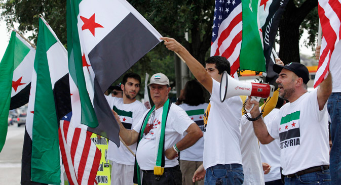People demonstrate for United States involvement in the conflict in Syria on Aug. 31, in Houston. Source: AP