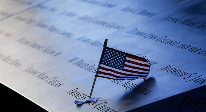 An American flag in the plaque of names on the edge of the North Pool of the 9/11 Memorial in New York. Source: Reuters