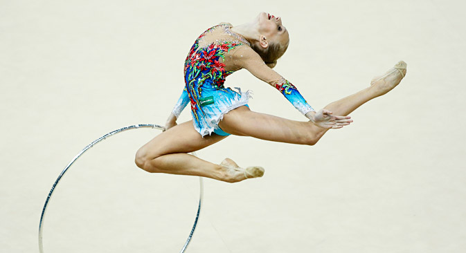 Yana Kudryavtseva performs with the hoop during the individual all-around competition final at the 32nd Rhythmic Gymnastics World Championships in Kiev August 30, 2013. Source: Reuters