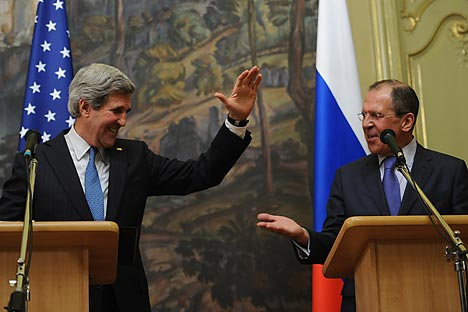 U.S. Secretary of State John Kerry (L) high-fives Foreign Minister Sergei Lavrov (R) during a recent Russian Foreign Ministry briefing. Source: Photoshot / Vostock-Photo