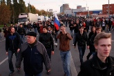 Riot police face off against protestors in southern Moscow
