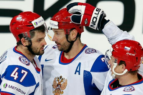 Russia's Ilya Kovalchuk (C) celebrates his goal against Austria with teammates Alexander Radulov (L) and Alexei Tereshenko during their 2013 IIHF Ice Hockey World Championship preliminary round match at the Hartwall Arena in Helsinki May 13, 2013. REUTERS/Grigory Dukor