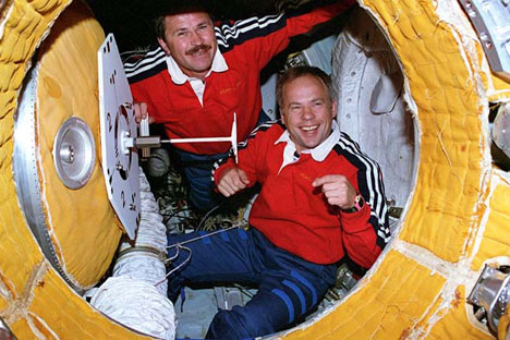 View of the Mir 19 commander Anatoly Solovyev (R) and flight engineer Nikolai Budarin preparing to close the hatch to the docking module which leads to the Mir space station, 1995. Source: NASA
