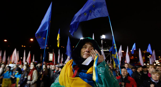 Passionate protest: a woman wipes away a tear at a demonstration in Kiev against Ukraine's rejection of the EU agreement. Source: Reuters