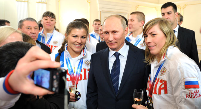 Many of the Americans in Sochi next month will have gotten there with charity, sponsorship cash and financial hardship. The Russians are there on the government's dime. Pictured: Vladimir Putin (C) meets Russian athletes, the winners of the 2013 SportAccord World Combat Games, at Novo-Ogaryovo residence.Source: ITAR-TASS