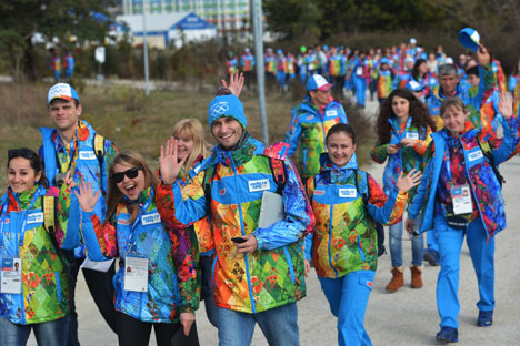 The volunteers are preparing for the Opening Ceremony.  Source: RIA Novosti