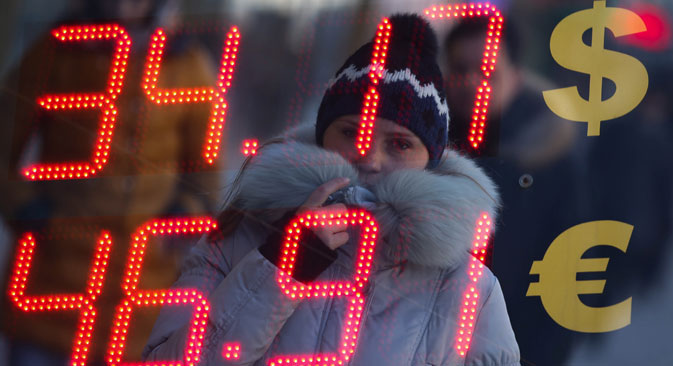 Russian consumers are the only group that stands to lose from a cheaper ruble. Source: ITAR-TASS