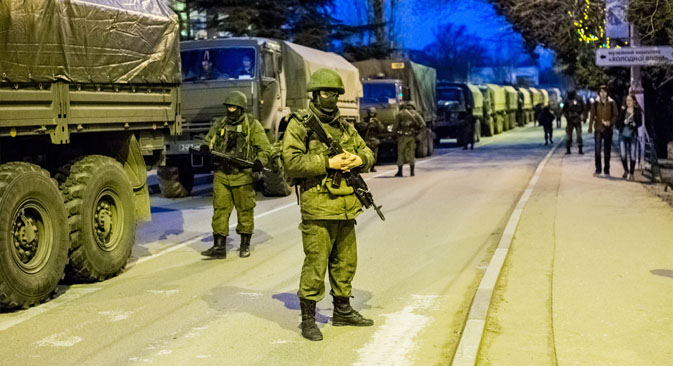 Russian foreign policy experts are certain that sending in troops would be detrimental to Russia's standing in the international community. Source: RIA Novosti
