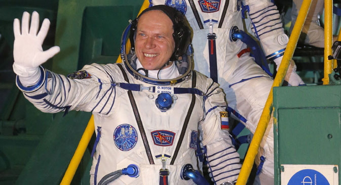 Oleg Kotov (bottom step), Mike Hopkins and Sergey Ryazanskiy about to embark on their 6-month stint on the space station. Source: RIA Novosti
