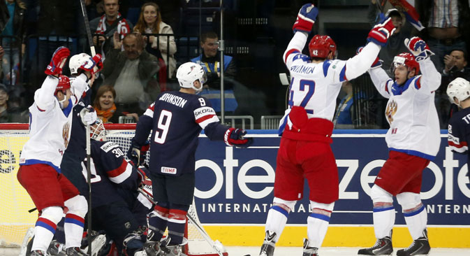 Russia players celebrate their opening goal during the Group B preliminary round match between Russia and USA at the Ice Hockey World Championship in Minsk. Source: AP