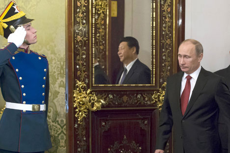 Russia's President Vladimir Putin, right, and his Chinese counterpart Xi Jinping in the Grand Kremlin Palace in Moscow. Source: Reuters