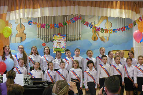 In the ceremony, children sing the last song in the elementary school. Source: Lara McCoy