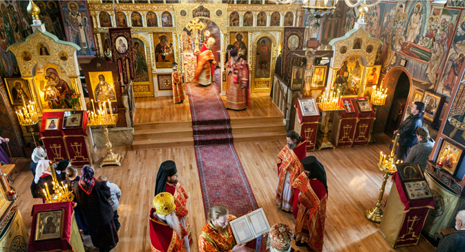 Monks celebrate a traditional Russian Orthodox liturgy at the Holy Trinity Monastery in 