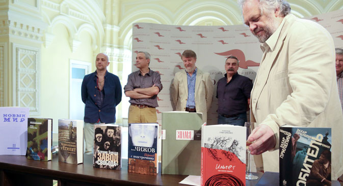 """The Big Book"" prize finalists (from left to right) Zakhar Prilepin, Yevgeny Chizhov, Vladimir Sharov, Viktor Remizov and the prize expert Mikhail Butov at the shortlist announcement ceremony. Source: ITAR-TASS"