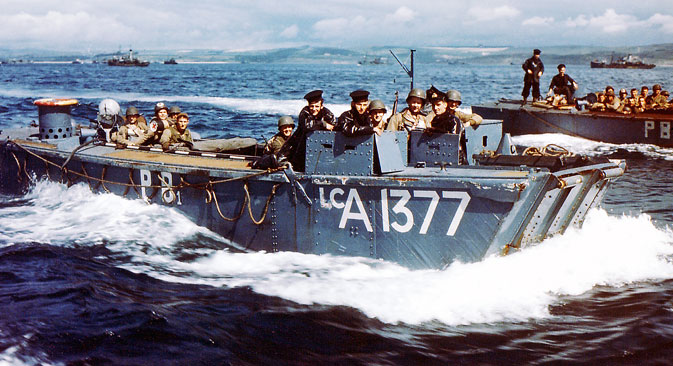 British Navy Landing Crafts (LCA-1377) carry United States Army Rangers to a ship in Southern England. Source: UllsteinBild / Vostock_photo
