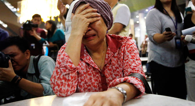 A woman cries at Kuala Lumpur International Airport as she waits for more information about the crashed plane, on July 18. Source: Reuters