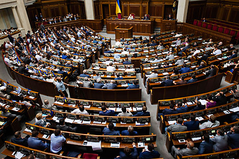 Verkhovna Rada adopted yesterday, in the first reading, a bill that would allow Kiev to impose sanctions against Russia. Source: Photoshot / Vostock-Photo
