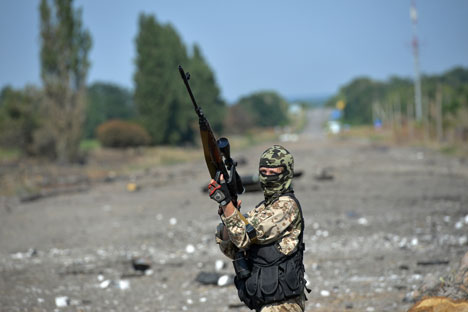 A Lugansk People's Republic militiaman at the Dolzhansky border crossing point. Source: Maxim Blinov / RIA Novosti
