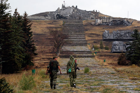 """Russian President Vladimir Putin reacted to the military success of the militants, who are heading towards the coastal city of Mariupol, by asking their leaders to """"open a humanitarian corridor for the surrounded Ukrainian servicemen, in order to avoid pointless deaths."""" Source: Reuters"""