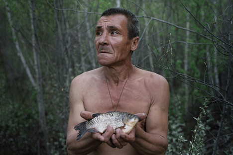 "Tkachenko's series ""Escape,"" about hermits, took first place in the ""Staged Portraits"" category."