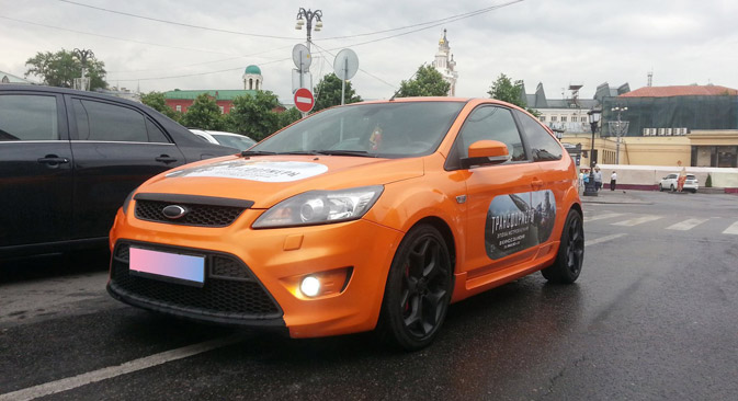 Moscovites earn money on placing advertising stickers on their vehicles. Source: Press photo