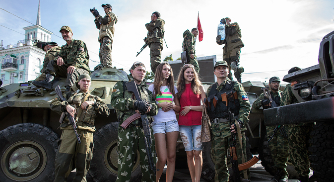 Women pose for a picture with pro-Russian rebels during a parade in Lugansk, eastern Ukraine. Source: Reuters
