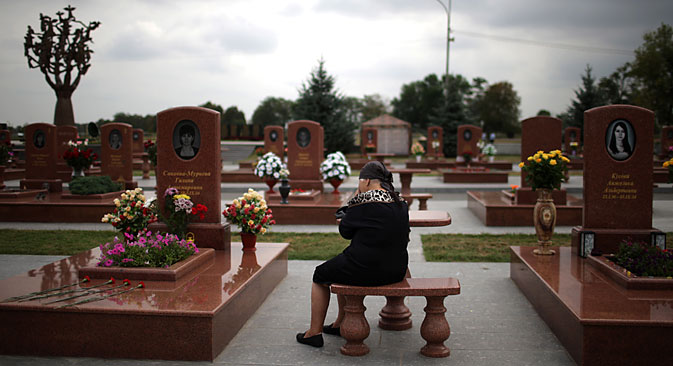 A woman at the City of Angels memorial cemetery in Beslan, the final resting place for the victims of the terrorist attack which occurred on September 1, 2004. Source: ITAR-TASS