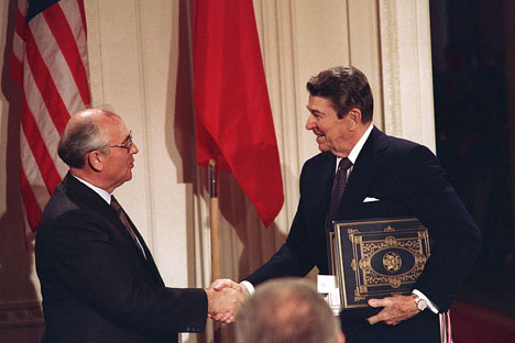 U.S. President Ronald Reagan (right) shakes hands with Soviet leader Mikhail Gorbachev after the two leaders signed the Intermediate Range Nuclear Forces Treaty in Washington, D.C. on December 8, 1987. Source: AP