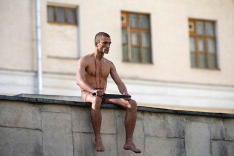 After the stunt: Pyotr Pavlensky cuts off his own earlobe. Source: Reuters