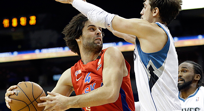 CSKA Moscow's Milos Teodosic, left, looks to pass as he is pressured by Minnesota Timberwolves' Alexey Shved, of Russia, in the second half of a preseason NBA basketball game, Monday, Oct. 7, 2013, in Minneapolis. Source: AP