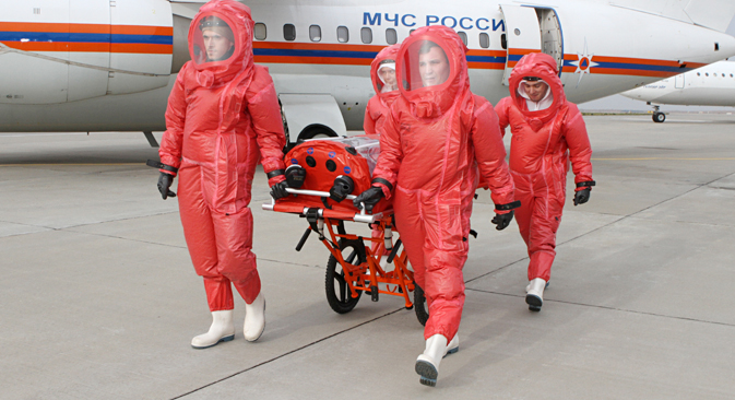 Members of Russia's Emergency Situations Ministry prepare a plane to transport Ebola patients, Oct. 9. Source: Alexander Khrebtov / RIA Novosti