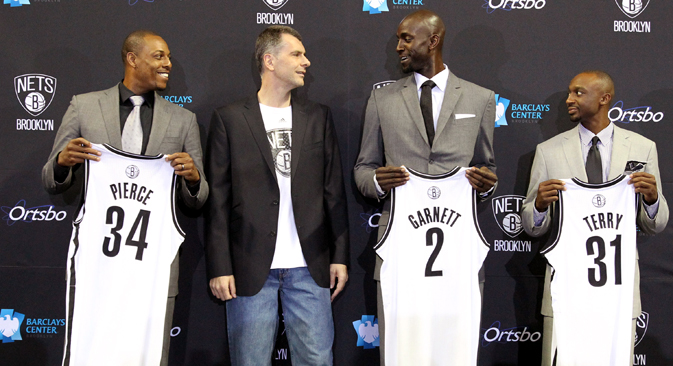 Nets majority owner Mikhail Prokhorov joins Kevin Garnett #2, Paul Pierce #34, and Jason Terry #31 of the Brooklyn Nets during a press conference at the Barclays Center on July 18, 2013 in the Brooklyn borough of New York City. Source: Getty Images / Fotobank
