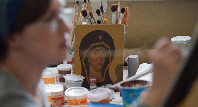 The tradition of icon painting first arrived in Kievan Rus, the precursor to the Russian state, after its conversion to Orthodox Christianity in AD 988. Source: TASS