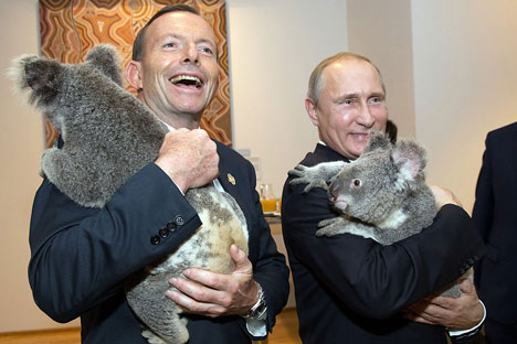 Australia's Prime Minister Tony Abbott and Russia's President Vladimir Putin as they meet Koalas before the start of the first G20, 2014.