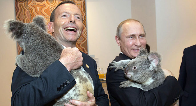 Australia's Prime Minister Tony Abbott (L) and Russia's President Vladimir Putin as they meet Koalas before the start of the first G20. Source: AFP PHOTO / East News