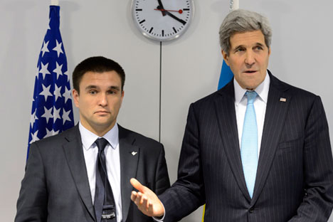 U.S. Secretary of State John Kerry talks to Ukraine's Foreign Minister Pavlo Klimkin at the meeting of foreign ministers from the OSCE in Basel, December 4, 2014. Source: Reuters