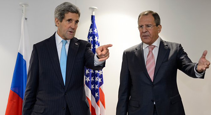 US Secretary of State John Kerry, left, and Russian Foreign Minister Sergey Lavrov gesture prior tp a bilateral on the sidelines of an Organization for Security and Cooperation in Europe (OSCE) ministerial meeting in Basel, Switzerland, Thursday, Dec. 4, 2014. Source: AP