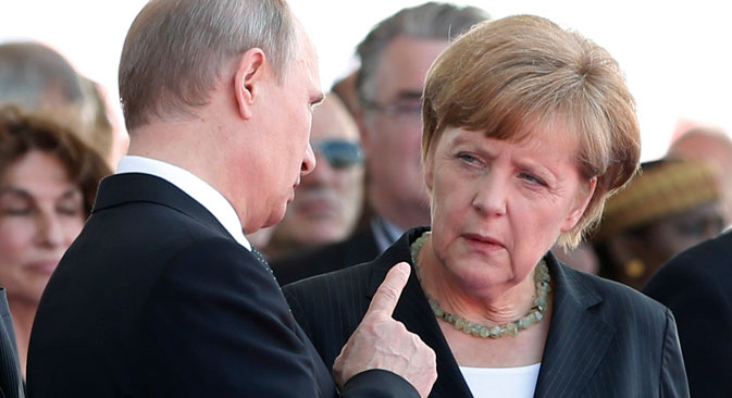 Russian President Vladimir Putin talks with German Chancellor Angela Merkel at a ceremony commemorating the 70th anniversary of D-Day on June 6, 2014. The two leaders recently took part in a telephone discussion alongside Ukrainian President Petro Poroshenko and his French counterpart Francois Hollande over the situation in eastern Ukraine. Source: Reuters