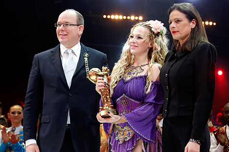 Russian artist Anastasia Fedotova-Stykan (center) with Prince Albert II of Monaco and his sister Princess Stephanie of Monaco after receiving a Golden Clown during the Award Gala evening of the 39th Monte Carlo International Circus Festival, on Jan. 20. Source: AP