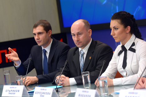 "Members of the citizen action group of the Antimaidan public movement mixed martial arts world champion Yulia Berezikova (right), writer Nikolai Starikov (center) at a news conference ""Contemporary Challenges: Revolutions, Illegal Acts; How to Protect Your Country From Collapsing."" Source: Vladimir Trefilov / RIA Novosti"