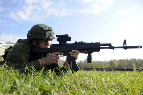 A military man wearing the new combat uniform 'Ratnik' with a Kalashnikov AK-12 assault rifle at a shooting range.