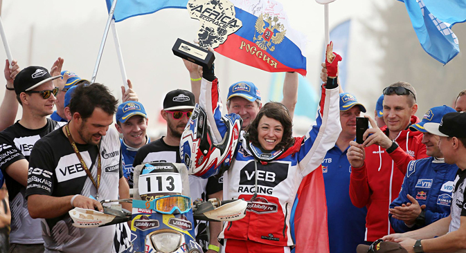 This season, Anastasia Nifontova (C) was the first Russian woman to participate in the World Cup for Cross Country Rallies, taking second place in the Abu Dhabi stage. Source: africarace.com